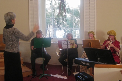 5-Brass (Photo of Susan conducting the brass ensemble)